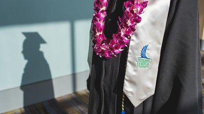 Student Orlando Narvaez prepares for the Spring 2016 ceremony in the American Bank Center.