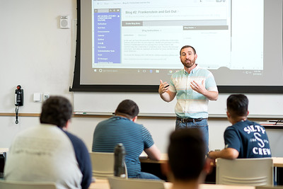 Professor of Literacy Studies, Jason Farr, discusses his assignment for the day during his literature and culture class.