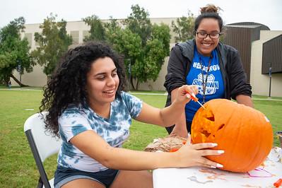 Victoria Garza (left) and Vanessa Santillan carving out a pumpkin at the 2018 Fall Festival.