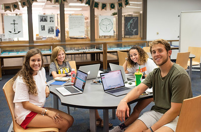 Natalie Danko (left), Becca Heinert, Ashleigh Baker-Samuel, and Anthony Ozuna work on assignments for their English Rhetoric and Composition class.