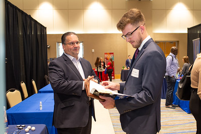 Senior MIS student Jake Lindner discusses job opportunities with a recruiter form Mass Mutual.