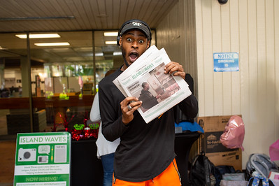 Kedran Wade of Island Waves hands out copies of the most recent publication.