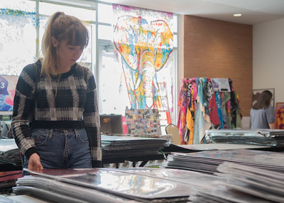 Olivia Whitehurst looks at posters in the University Center
