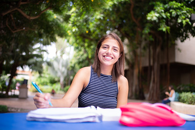 Student Angelene Cook works on prepparing notes for her Terrorism class outside Cat Alley on a fresh Thursday afternoon.