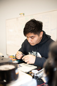 Student Alan Garduno works on solving an electric circuit at the Engineering Labs.