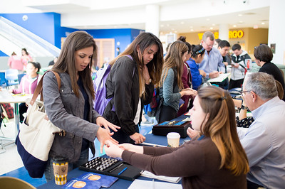 Ruby Tamez (left) as well as other Islanders, inquire about getting an Islander Ring during the Islander Ring Sales event in the University Center rotunda.