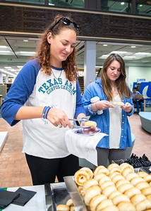 Megan Mellis (left) and Morgan Sobol stop by the Mary and Jeff Bell Library for Bagels and Coffee to fuel up as they prep for upcoming finals