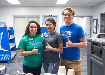 Erin Longoria (left), Akyssa Eppara, and Zach Sawyer pose with their Islander Shakas for Bagels and Coffee at the Mary and Jeff Bell LIbrary