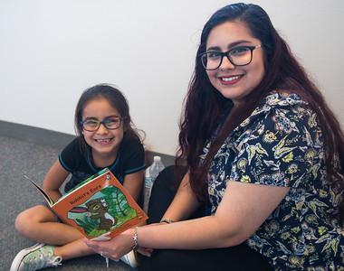 "Kimberly Cantu reads Red Rocket Readers ""rabbit's Ears"" with student Sophia Gallardo"