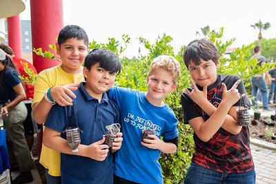 (From left to right) Jesus Mauleon, Jason Sifontes, Ian Palm, and Sebastian Miranda show off their bottle plants.
