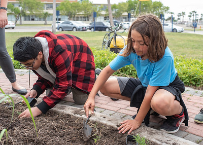 Erick Sifontes (Left) and Like Deleon (Right) planting various types of herbs in the ECDC community garden.