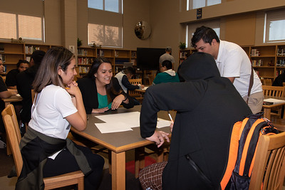 Lizette DelaRosa (left), Mara Barbosa, and Omar Alvarado  (white shirt) with a West Oso High School student at the Spanish event at the library.
