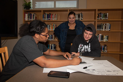 Kristen Jones (left) with a West Oso High School student at the Spanish event at the library.