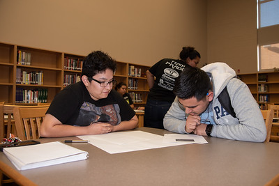 Isabella Ramos (left) with a West Oso High School student at the Spanish event at the library.