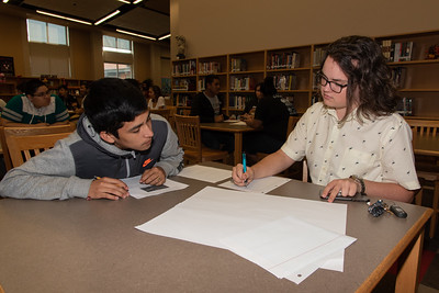 Jonathan Maul (right) with a West Oso High School student at the Spanish event at the library.