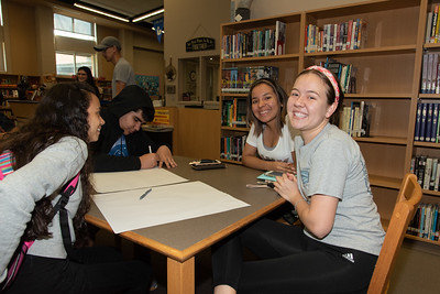 Veronica Fernandez (right) and Lizette DelaRosa with West Oso High School students at the Spanish event at the library.