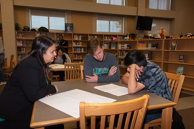 Mara Barbosa (left), and Garrett Swenson with a West Oso High School student at the Spanish event at the library.