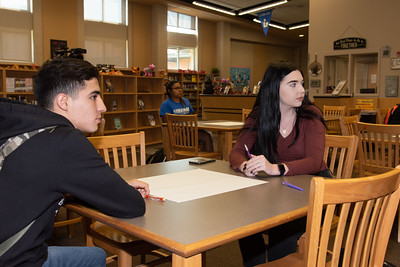 Faith Richards (right) with a West Oso High School student at the Spanish event at the library.