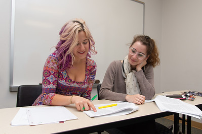 Amie MacKay (left) and Abigail Conner working together to read the material for their Contemporary Philosophy course.