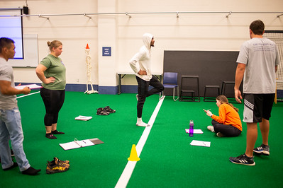 Students prepare to undergo a Stork test for their Measurement and Evaluation kinesiology class.