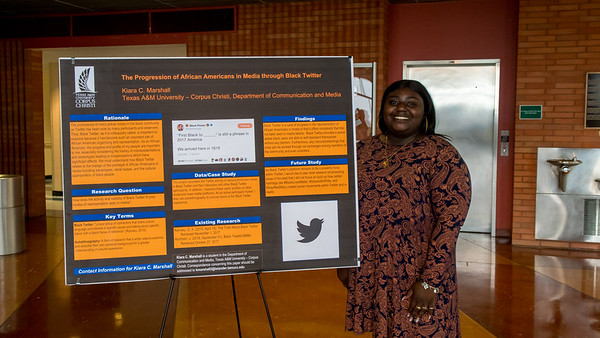 Communications student Kiara C. Marshall presents her project during a Capstone Research Poster Session.