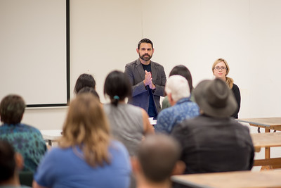 Joe Peña, Associate Professor of Art, (left) welcomes guests to the first event to kick off the Oso Bay Biennial XX:  Realism Redux. Guests had an opportunity to hear from Winter Rusiloski, Assistant Professor of Art at Baylor University.