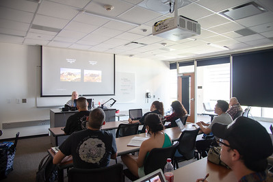 Students learn about the history of art in the 18th century in the Michael and Karen O'Connor building.