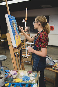 Kayla Massey completes the last touches to her Impasto Portrait by adding texture to the outer space of her canvas.
