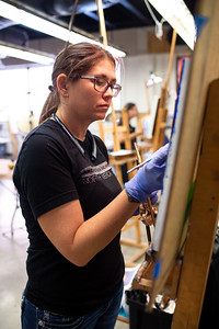 "Karen White completes the last touches to her ""Verdaccio"" portrait."