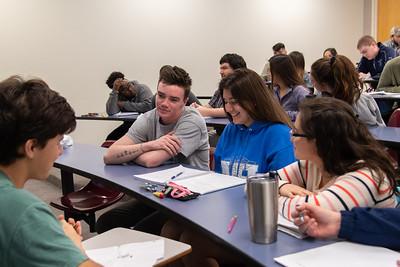 Xavier Elizondo (left), John-Michael Stapleton, Allison Sauceda, and Mereet Salman cooperating in their Intro to Ethics class.