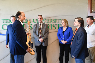 Dr. Nick Adame, member of the Corpus Christi Jazz Society presents his guitar donation to Dr. Brian Thacker.