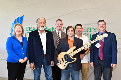 Dr. Kelly Quintanilla, president & CEO of TAMU-CC (left), Dr. Nick Adame, Brian Shelton, Dr. Brian Thacker, Mike Moore, and Dean of CLA Mark Hartlaub of Texas A&M University-Corpus Christi's CLA music department.