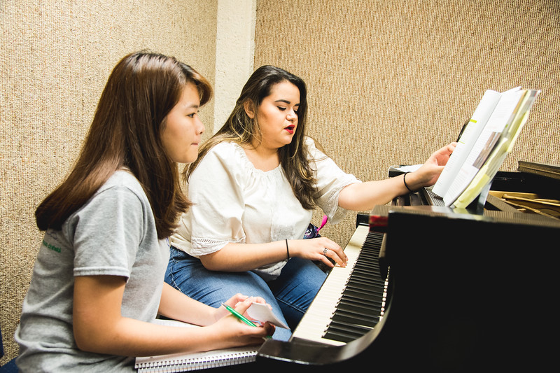 We're actually science majors but we know nothing about music. So we're just doing a bit of self teaching before our quiz. -An Do(left), Emily Pena(right)