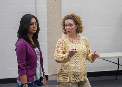 Student Crystal Aguilar takes advise from Dr. Thacker.