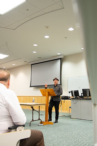 Cyrus Cassells gives the keynote presentation in Island Hall during the 2019 Authors Day event.