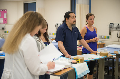 Cesar Martinez (center) at attention during the E-Line course for Fundamentals in Health Assessment Lab.