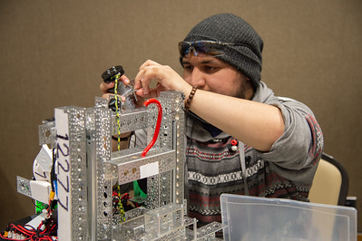 Roland Villarreal works on his robot.