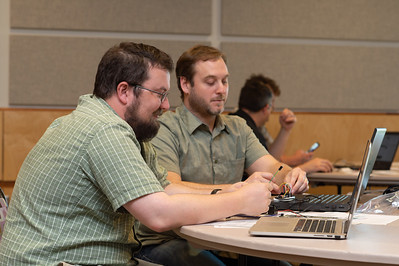 Daniel Alyward (left) and Brach Lupher at the Microcontrollers Workshop at the Harte Research Institute.