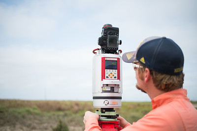 Brian Lorentson initializes the LIDAR instrument used during the survey of the Mustang Island area  The Conrad Blucher Institute  collects data following Hurricane Harvey's impact in the coastal bend.