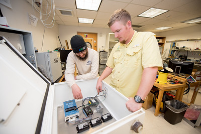 Research Engineer Associates Hugo Mahlke (left), and Brian Lorentson perform tests to the X-Lite module prior to installment.