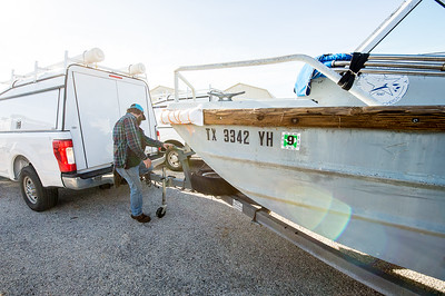 Hugo Mahlke, research engineer for Texas A&M Corpus Christi - University; prepares the trailer hitch to the boat as the Conrad Blucher Institute group departs to install their PORT system off of the shore of Port Aransas, Tx.