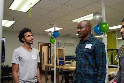 Mahmound Alshaghab and Jamiu Opoola discuss their group project.