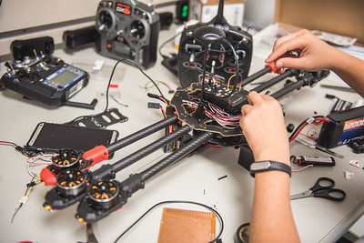 Engineering student, Vincent Nguyen works on his Unmanned Air System device, in the TAMU-CC UAS Lab.