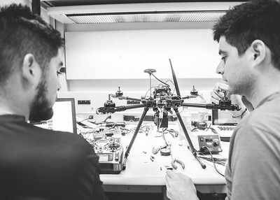 Mechanincal Engineer Students Luisa Bonilla(left) and Daniel Gonzalez work together on initializing the setup for the flight control system in the UAS Lab.