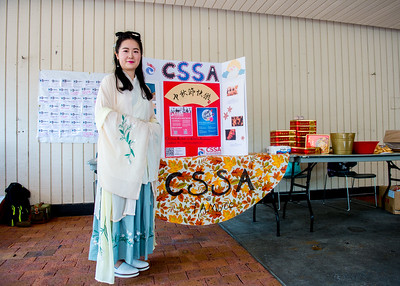 Student Xiaotian Tang in the costume of Chinese Fairy at the table of Chinese Student & Scholars Association (CSSA)