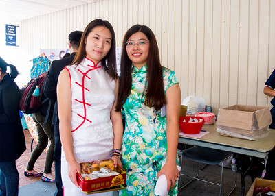 Student Shengjie Mi (left) and Yaqian Zheng wear the traditional dresses of Chinese at the table of Chinese Student & Scholars Association (CSSA)