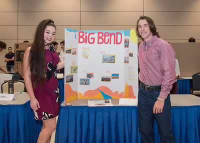 Students Hailey Wickstrom (left) and Holden Coleman present their project during the First Year Research Symposium.