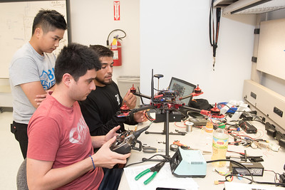 Mechanical Engineer students Vincent Nguyen, Luis Bonilla and Daniel Gonzalez work together on initializing the setup of their flight control systems.