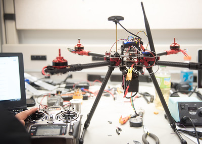 An Unmanned Air System stands ready as students initialize the flight control system in the UAS Lab.