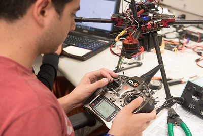 Engineering student Daniel Gonzalez sets up the flight control systems for his UAS project.